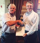 Bryan Gongre receives his 25 year anniversary certificate from John Hoy, July 10th 2017